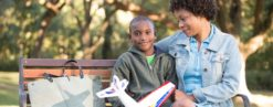 Mother And Son On Park Bench In Louisiana Picture - Louisiana Healthcare Connections